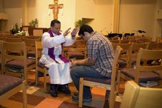 In 2015, in the chapel of the University Catholic Center at UT-Austin, Paulist Fr. Jamie Baca gives a blessing to a student.