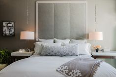 Drum shades. Hung from pretty chains, light fixtures with drum shades are understated and elegant in the bedroom. When paired with classic bedding and a soft gray palette, the look is very luxury hotel. Be sure to put lights like this on a dimmer switch so you can control the glow.