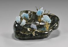 """<b>AQUAMARINE FISH ON LABRADORITE BASE</b> <br  />礦石雕魚擺件<br  /> <i>Artist: Luis Alberto Quispe Aparicio</i> <br  /> Finely carved, gemstone sculpture; of tang (surgeon) fish rendered from aquamarine in varying shades, flanked by gold vermeil sea aquatic plants; placed together within a finely polished labradorite boulder base; L: 7 1/4"""" (overall)"""