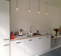 Birch Plywood & Formica® Laminate solid color kitchen by Matt Antrobus