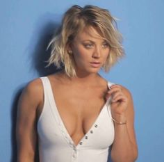 Kaley Cuoco. An amazing photo. Her hair is at a great length. Her gaze smolders. The musculature showing in her arm is fierce. Again, an amazing photograph.