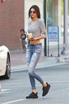 Following her posh vacation in St Barths, the model keeps things casual with a stripe tee, distressed jeans, and Yeezy Boost 350 sneakers while out in Beverly Hills.