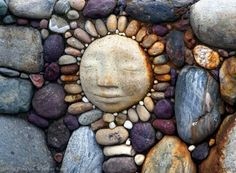 Stone Face Moon Sculpture by Marcia Donahue set in fire pit mosaic ...