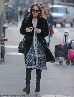 Winter warm: The saucy starlet left her brunette tresses loose and added dark glasses to protect against the chilly but bright sunny weather