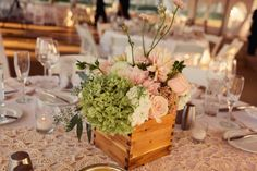 wooden box to hold the centerpiece floral arrangement over a lace runner