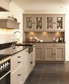 Taupe Kitchen Cabinet and Wall Color. Taupe Kitchen Cabinet and Wall Color. 10 Kitchen Trends Here to Stay Kitchen Wall Cabinets, Taupe Kitchen Cabinets, Beige Kitchen, Kitchen Renovation, Kitchen Flooring, Dark Kitchen Cabinets, Kitchen Remodel, Home Kitchens, Taupe Kitchen