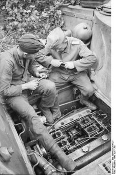 "Operation ""Citadel"", Russia, June 1943: Crew members of Panzer VI (Tiger I) perform engine maintenance. The Tiger was famous for its engineering complexity and the often sensitive motor. Fixing even small problems required considerable training, which, as the war advanced, it became scarce due to time pressures and replenishment manpower needs. ""Great in battle - when it worked."""