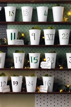 Get a pack of paper disposable coffee cups (we bought a pack of 50 for £3) and make into your own cheap yet chic advent calendar