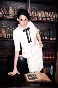 Nine D'Urso reads wearing Chanel haute couture for Madame Figaro, August 2015. Photographed by Ellen von Unwerth. Daughter of French model Inès de La Fressange and Luigi d'Urso, Nine d'Urso stars in...