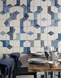 A closer look at the hand-painted, ceramic tile fresco on the ground level of Belle Maison. Bonaventure also specified ceramic dishes and tableware from Broste Copenhagen; the Nemea chairs are from Pedrali.