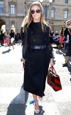 Olivia Palermo steps out looking ready for fall in her chic belted trench.