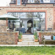 Modern garden with conservatory extension with glass windows