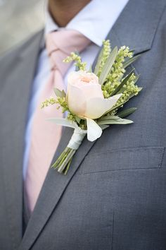 A Chic Gray Suit with Peach Boutonniere and Tie for a Spring Groom   Natalie Felt Photography   See More! http://heyweddinglady.com/blooming-orchard-wedding-shoot-in-pastel-citrus-shades/