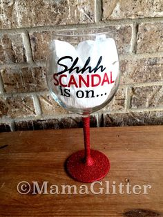 Gladiators suit up! Grab your glass and your wine, these make the perfect pairing to your Scandal watching party. Just enough to hold you over until next season. the other side says ITS HANDELED and #WWOD (What would Olivia do?).  These custom made wine glasses make a perfect Birthday, Christmas, or just because gift. You can choose your glitter stem color or leave it Scandal red. All designs are custom cut from the highest quality vinyl. This is the same stuff they use on boats, cars, and…