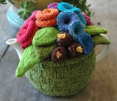 Garden_Party_Knitted_Tea_Cosy - I need a new tea cozy - this could be fun to knit!