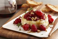 Warm Brie with Honeyed Raspberries and Almonds - Transform a wheel of Brie into a special treat for entertaining by baking in the oven until just softened and topping with a warm mixture of sweet honeyed raspberries and toasted almonds. Serve immediately and your guests will swoon for this delicious combination.