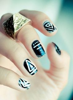 Black and white tribal nail art.