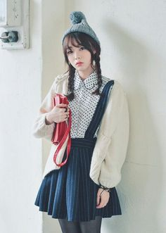 Korean fashion - polka dot blouse, striped blue suspender skirt, white cardigan and red bag