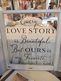 Every Love Story Window, I love this!! (with shadow box for sand for ceremony him using white or a certain colored sand and me using glitter to pour behind)