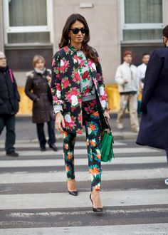 Floral mix: Black floral printed coat and skinny pants worn with a white floral sweater and black heels
