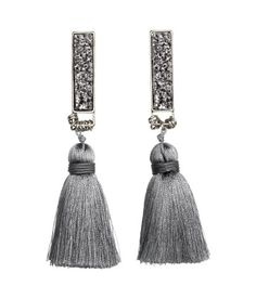 Metal earrings with crystal-like plastic beads, small metal rings, and thread tassels. Length 4 in.