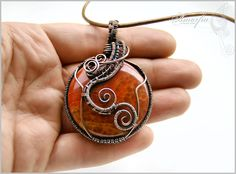 Orange pendant, agate and bronze wire wrapped- Dragon flames. $70.00, via Etsy.