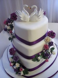 Kathy- can do heart shaped cake with cascade of flowers & butterflies on wires