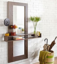 DIY Mirror with floating shelf.  This would be great by an entrance way.