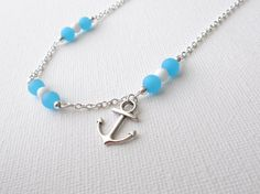 Hey, I found this really awesome Etsy listing at http://www.etsy.com/listing/152805638/blue-sea-glass-and-anchor-necklace