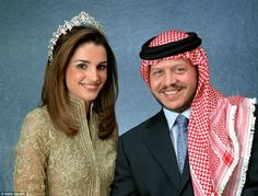 Queen Rania of Jordan poses with her husband King Abdullah II in 2000 while wearing the Queen Alia tiara, with its distinctive halo effect as it is raised above and around the head