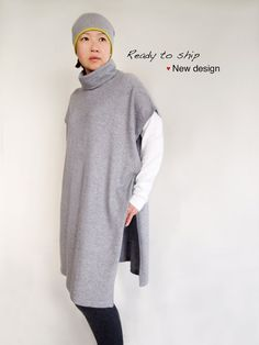 """This beautiful and elegant poncho is soft and lightweight. Very versatile and perfect cover up for between seasons. It is so easy to wear, simply slip over your head. Turtleneck to keep your neck warm.  Yarn: 80% cashmere + 20% wool blend  Color: Light gray  Finish: Side tie.  Size (+/-):  (L) 89cm / 35 (length from neckline to top of leg) (W) 65cm / 25.5"""" Poncho Coat, Cashmere Poncho, Cashmere Turtleneck, Neck Warmer, Cowl Neck, Wool Blend, Knitwear, Cover Up, Normcore"""