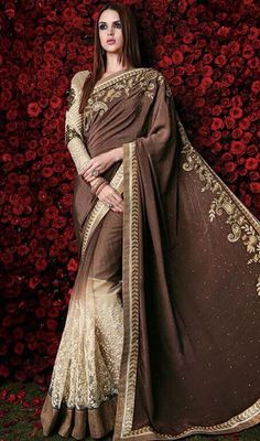 Bring forth your charm and elegance to the forefront in this beige and coffee color embroidered satin net half n half sari. The lovely lace and resham work a significant element of this saree. Upon request we can make round front/back neck and short 6 inches sleeves regular saree blouse also. #gloriousdesignsarees #trendsettersaree #trendylooksari