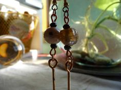 """<p><span style=""""font-family: """"courier new"""", courier; font-size: medium;"""">These are a pair of Mismatched Indian Glass Bead, Brass Barbell Ear"""