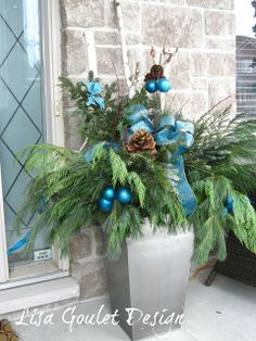 Christmas urn - aqua and greens. My urns are black and traditionally shaped but I think this will look beautiful on our front porch.