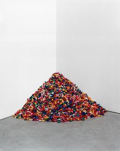 Sculpture- Felix Gonzalez-Torres Every person who sees this exhibit can take a candy. It is replenished eventually. Made for the Artist's partner who slowly suffered and died from Aids.