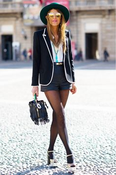 Anna Dello Russo in a structured blazer, high-waisted shorts and platform heels