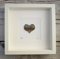 Calon the Welsh word for Heart or Love - Ready to ship today. You will receive the work photographed above. I like to work with natural materials, bringing life back to the ordinary and discarded. The piece is presented in a white or black 23 cm (9) x 23 cm (9) frame.