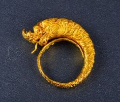Antique 18K gold dragon form ring with articulated tongue  Ring size: 7