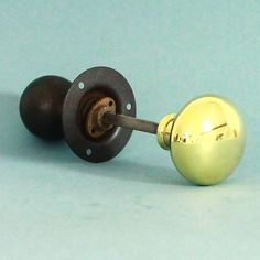 A surprisingly popular combined brass and iron rim lock knob set. The brass knob for inside and the iron knob for the outside of the door. Complete with rim side securing bracket and long threaded spindle for ease of fitting. Popular option for front doors.