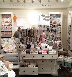 All set up at @potterybarnkids . #popupshop #bibs #blankets #baby #babybib…