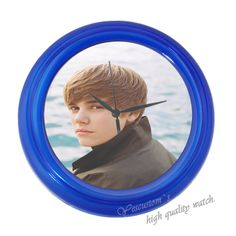 Justin Bieber wall clock!!! Everytime when i want to know the time i can see his picture, wonderful! I love custom design!