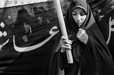 IRAN. Tehran. Woman of the Hezbollah (the party of God), which advocates a strict adherence to an islamic moral code, attend a politico-religious rally. 1997. photo by Abbas