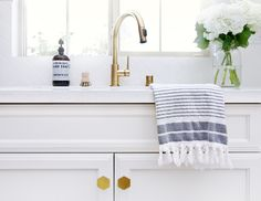 PUGH PROJECT: KITCHEN - hexagon knobs, gold faucet, and herringbone patterned subway tile