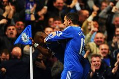 Eden Hazard Photos - Samuel Eto'o of Chelsea does an 'Old Man' celebration after scoring his team's first goal with teammate Eden Hazard during the Barclays Premier League match between Chelsea and Tottenham Hotspur at Stamford Bridge on March 8, 2014 in London, England. - Chelsea v Tottenham Hotspur - Premier League