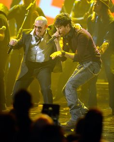 2010 American Music Awards - Show (L-R) Singers Pitbull and Enrique Iglesias perform onstage during the 2010 and American Music Awards held at Nokia Theatre L.A. Live on November 21, 2010 in Los Angeles, California.