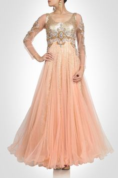 This peach color gown of net have squin work yoke embellished with diamonds. Inner is also of sequin fabric having one more layer of tafta underneath. Customiza