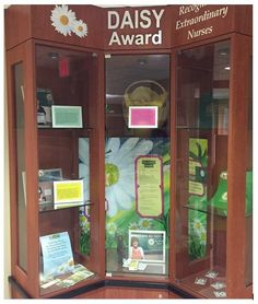 Beaumont Hospital-Farmington Hills, Botsford Campus has a beautiful display cabinet featuring their DAISY Award Honorees. The beautiful poster in the background was painted by one of their nurses.  Creative!!