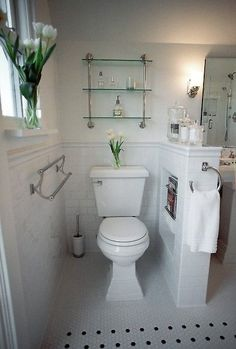 Great idea to have a magazine rack right next to the toilet in your bathroom ♥ Click to see the other great decor ideas in this home!