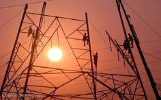 "Construction of a transmission tower  at sunset .Edo. Miranda, Venezuela. ""Men at work series""  By Mirna Chacin"