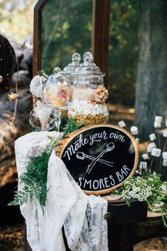 Charming rustic woodland s'mores bar.